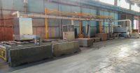 Aspiration de poussière avec réseau gaine laquées sur scie de découpe de plaque ondulée avec insonorisation des portes de travail.
